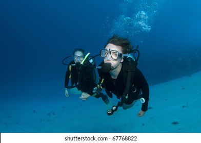 two scuba divers enjoy dive