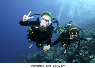two scuba divers having fun on a dive