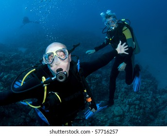 two scuba divers underwater having fun