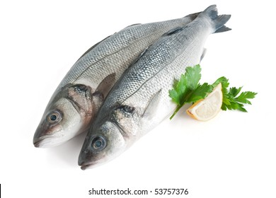 two sea bass with lemon and parsley isolated on white background with clipping path