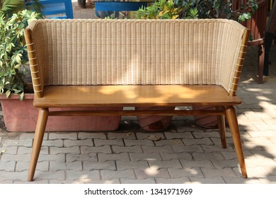 two seater cane and teak wooden bench