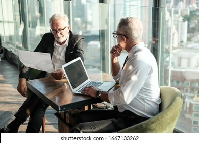 Two Senior businessman couple meeting in co working space at skyscraper lounge or office