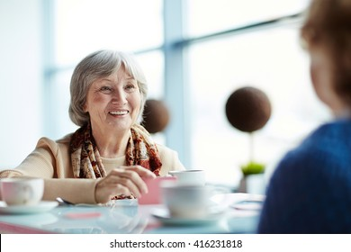 Two senior friends having a round of cards