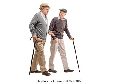 Two senior gentlemen walking and talking to each other isolated on white background