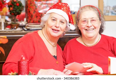 two senior ladies having fun for Christmas