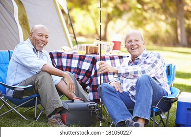 Two Senior Men On Camping Holiday With Fishing Rod