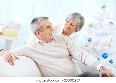 Two seniors laughing at home