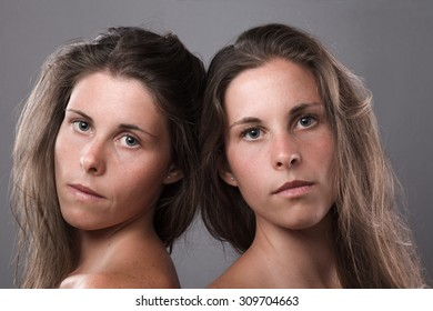 Two Serious Twin Sisters Looking at Camera