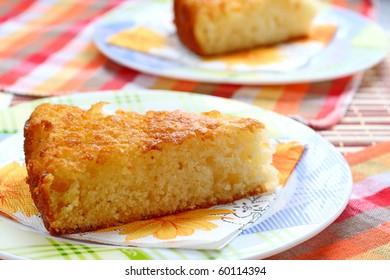 Two servings of semolina pie. Cake of cereals, sugar and kefir. Baking for dessert. Sweet golden pie from semolina. Dish for baby food. Loose semolina cake.