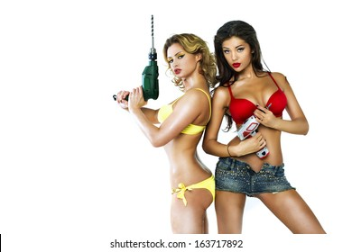 Two sexy girl holding a power drill
