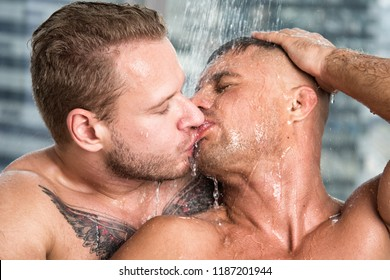 Two sexy guys are washing in the shower.