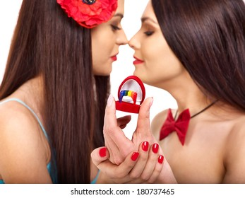 Two sexy lesbian women with wedding ring.Focus on ring