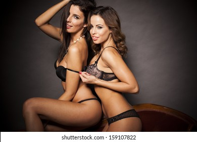 Two sexy lingerie women hugging