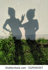 Two shadows mother and daughter happy mother's day green grass and wall background