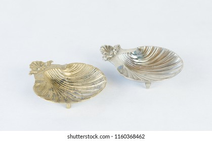 Two shell shape ashtray - golden and silver colors - isolated