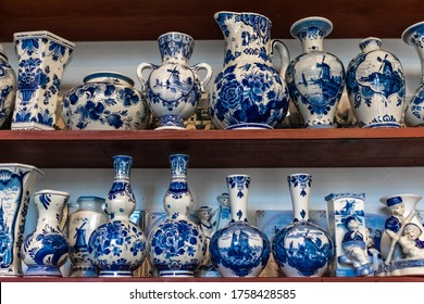 Two shelves of traditional Delft Blauw porcelain vases found in a shop in Delft, The Netherlands.