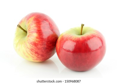 Two shiny fresh red Elstar apples (Malus domestica), on a white background.