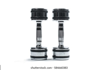 Two shiny metal dumbells isolated on white background.