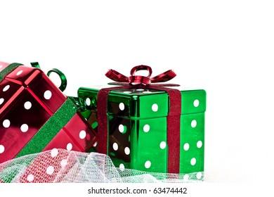 Two shiny polka dot red and green Christmas presents.