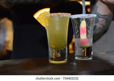 two shots cocktails bar colorful unique lemon and candy combination