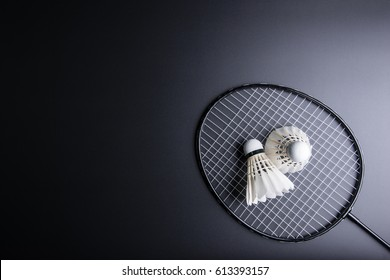 Two shuttlecocks and badminton racket on black background.Sport concept, Copy space image for your text