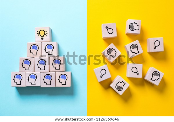 two sides symbolizing with icons on cubes a structured organization with innovation and a chaotic organization showing no progress