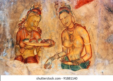 Two Sigiriya maiden with fruits: one of the 5th century frescoes at the ancient rock fortress of Sigiriya, a UNESCO World Heritage Site in Sri Lanka