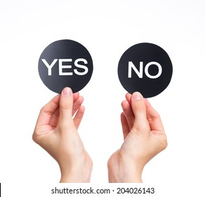 two signs in female fists saying yes and no isolated on a white background.