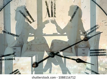 two silhouettes of girls at the table in the cafe sitting on the background of the clock face (double exposure )