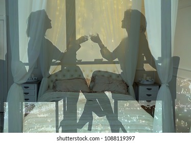 two silhouettes of girls at the table in the cafe sitting on the bed (double exposure )
