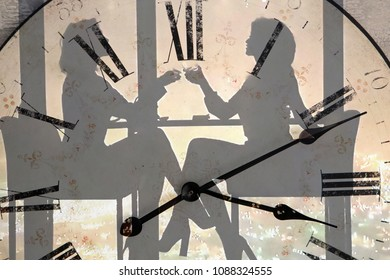 two silhouettes of girls at the table in the cafe sitting on the background of the clock face