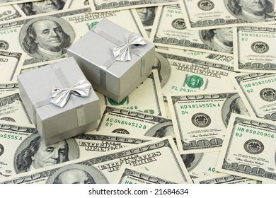 Two silver gifts on money background, holiday concept
