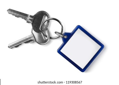 Two silver keys with blank key fob isolated on white