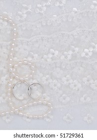 Two silver weddings rings on a background a lace