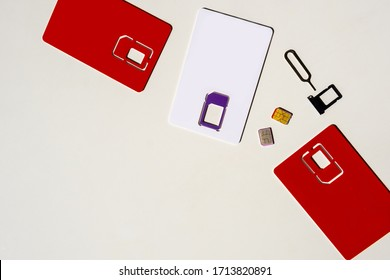 Two SIM Card, phone and slot on the white background, copy space, top view.