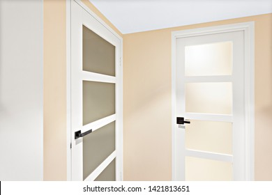 Two simple doors with sleek handles and opaque glass