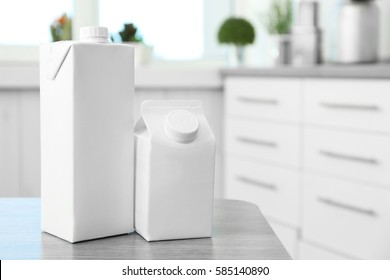 Two simple milk boxes on table in kitchen