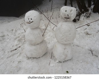two simple snowmen built by clumsy children's hands, winter fun activity, Beskydy mountains, Czech Republic, Central Europe