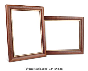 Two simple wooden picture frames isolated on white with clipping path