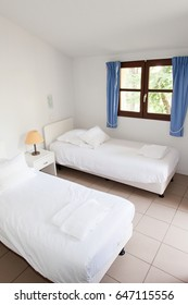 two single bed in large bedroom