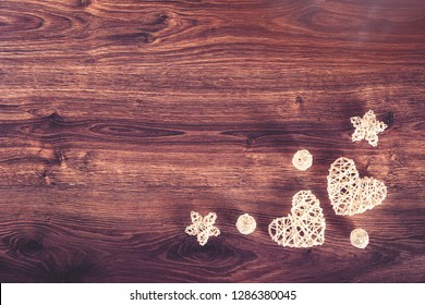 Two sisal hearts on rustic wooden background in flat lay with copy space. Birthday, Mother's, Valentines, Women's, Wedding Day concept.