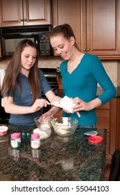 Two Sisters Bake Cupcakes