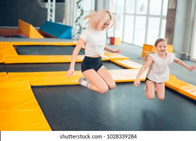 two sisters bouncing in the trampoline park