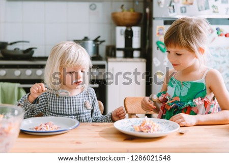 Two Sisters Eating Healthy Salad Kitchen Stock Photo (Edit ...