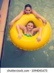 Two sisters in a Lazy River in an Indoor waterpark in South Carolina
