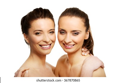 Two sisters with make up embracing.
