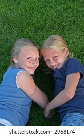 two sisters on the grass