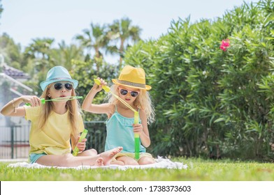 Two sisters playing in the garden, Summertime fun