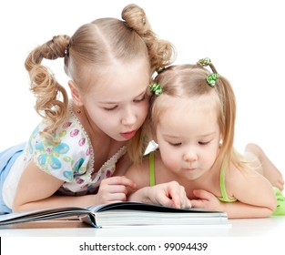 two sisters reading a book together