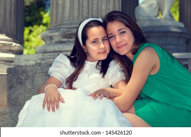 Two sisters Smiling in the First Communion Day